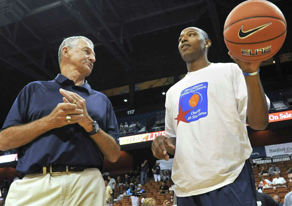 Connecticut head coach Jim Calhoun, left, talks with former player Caron Butler, now with the Dallas Mavericks, prior to the Jim Calhoun Celebrity Classic Charity All-Star basketball game in Uncasville on Aug. 7, 2010.