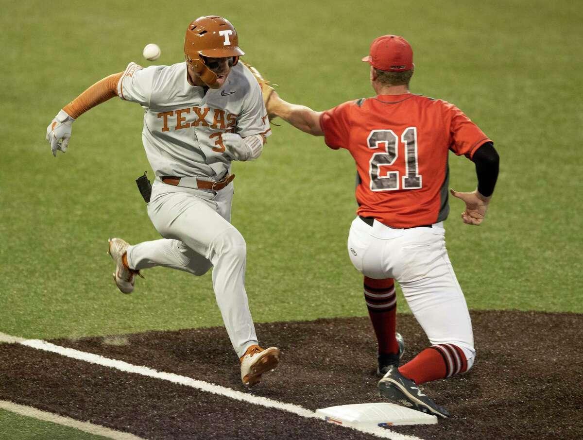Texas' Eric Kennedy beats an errant throw to Fairfield first baseman Sean Cullen in the second inning of an NCAA college baseball regional tournament at Disch-Falk Field, Sunday on June 6, 2021, in Austin.