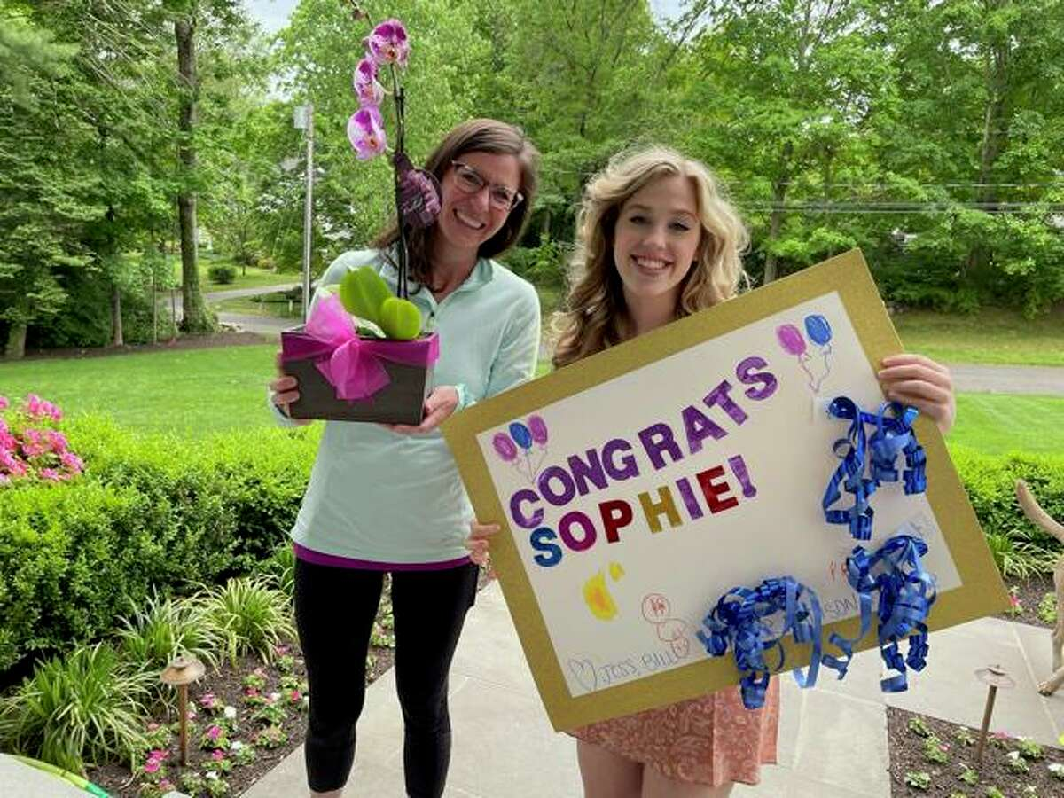 The Burt family gave some surprise gifts to Darien High senior Sophie Gilbert.