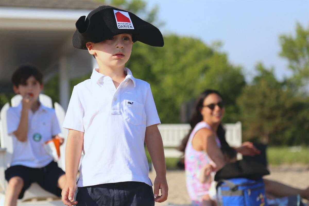 Caleb Rauseo, 3, of Darien, gets in the spirit of the Bicentennial Bash at Weed Beach on Saturday, June 5, 2021.