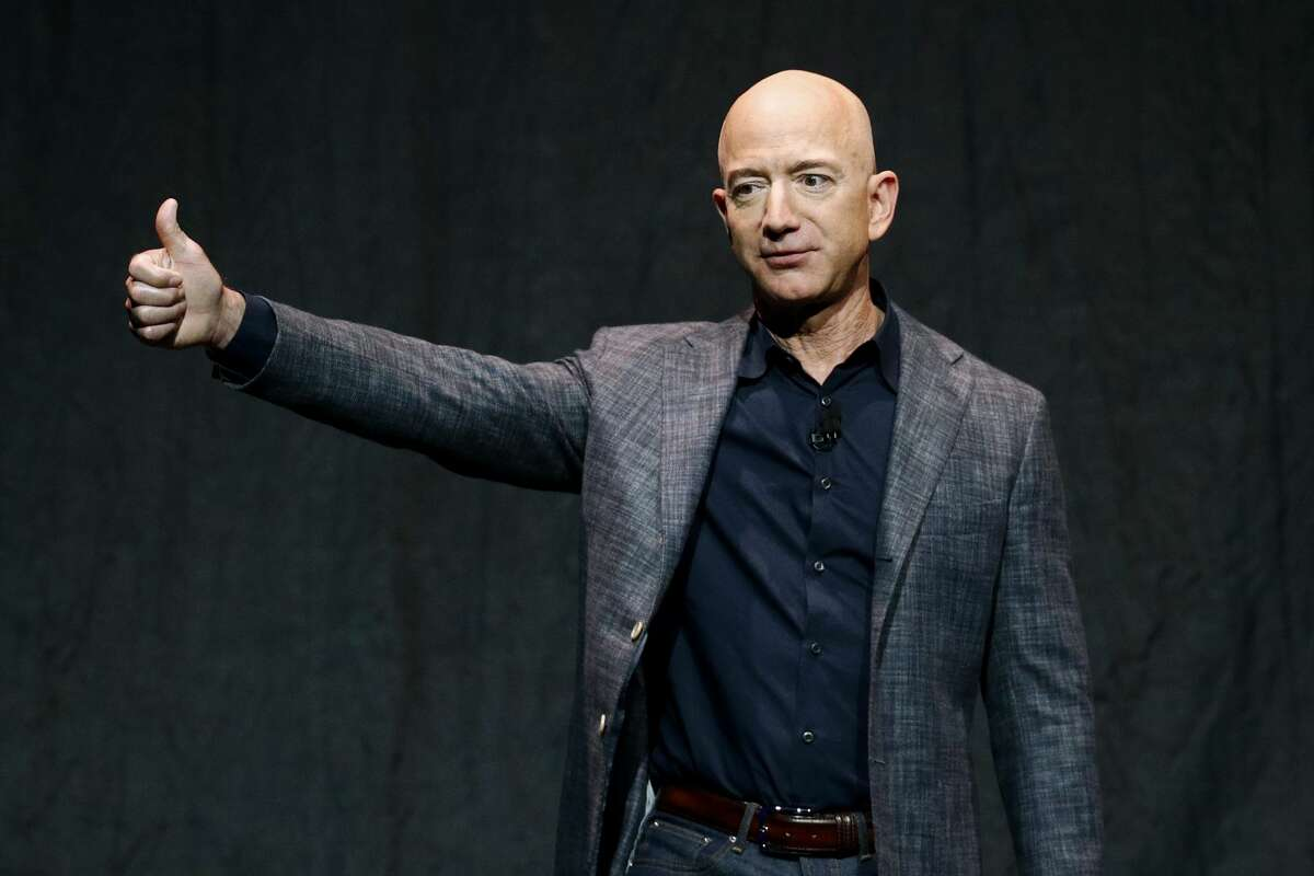 Jeff Bezos will be on the first crewed flight of Blue Origin's New Shepard suborbital rocket system. He's pictured speaking at an event before unveiling Blue Origin's Blue Moon lunar lander in Washington, in this Thursday, May 9, 2019, file photo. (AP Photo/Patrick Semansky, File)
