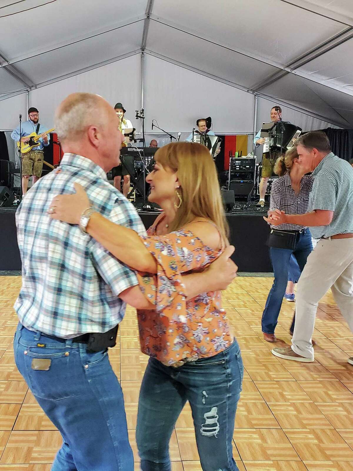People dance to live music Friday, June 4, during the German Heritage Festival in Tomball.