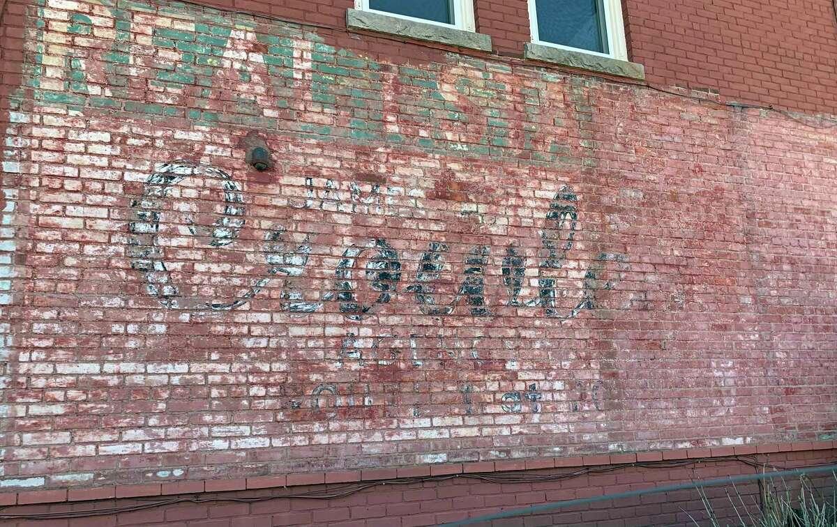 "The original ""ghost sign,"" before restoration."