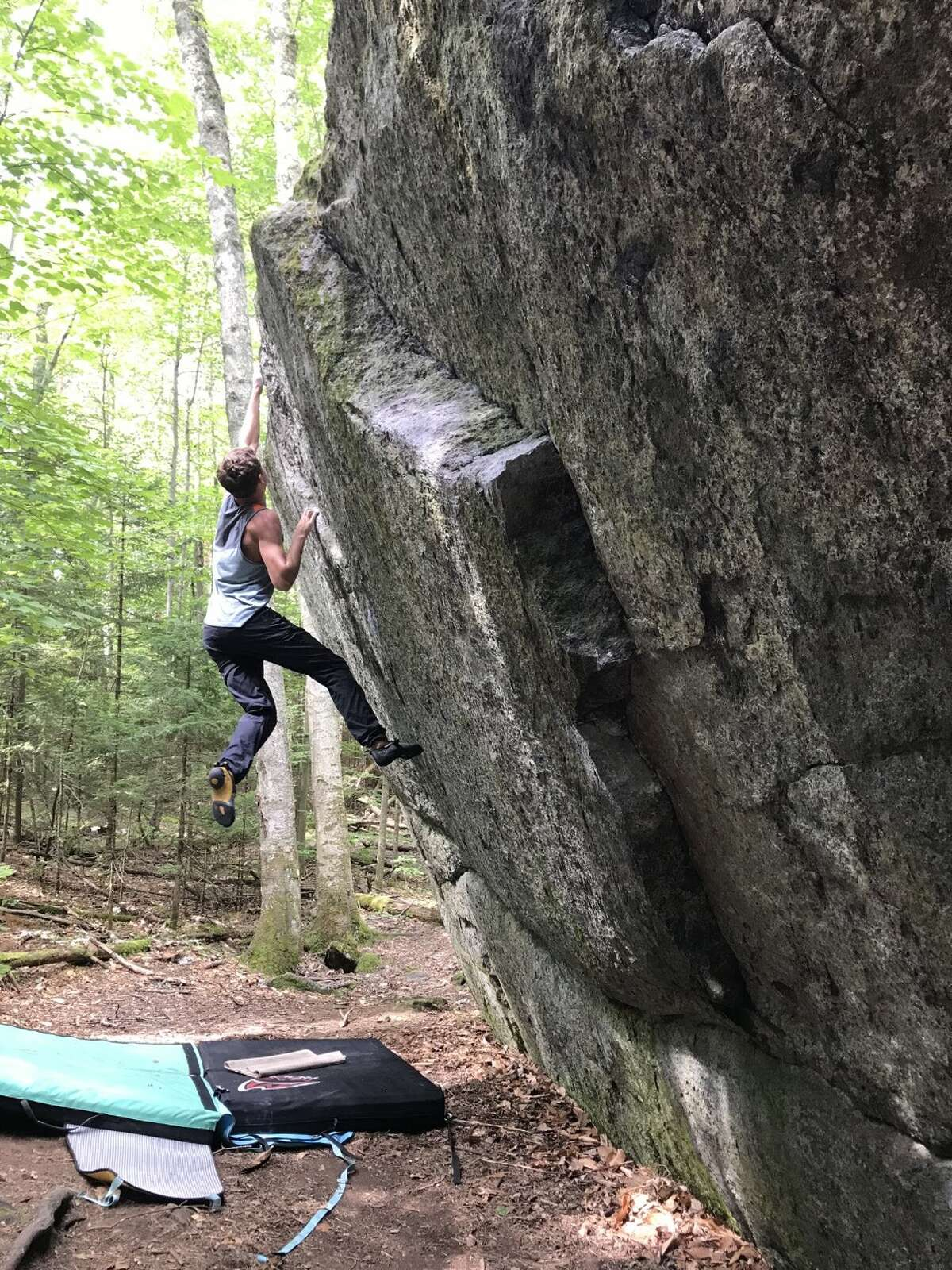 A climber leaps for a hold at McKenzie Pond Boulders. Photo by Leyla Brittan.
