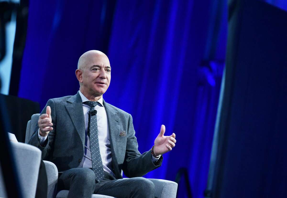 Blue Origin founder Jeff Bezos speaks after receiving the 2019 International Astronautical Federation (IAF) Excellence in Industry Award during the the 70th International Astronautical Congress at the Walter E. Washington Convention Center in Washington, DC on October 22, 2019. (Photo by MANDEL NGAN / AFP) (Photo by MANDEL NGAN/AFP via Getty Images)