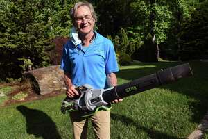 Dan Delvanthal, owner of Mow Green Organic Lawn Care, holds one of the battery powered leaf blowers his company uses in Fairfield on May 28, 2021.