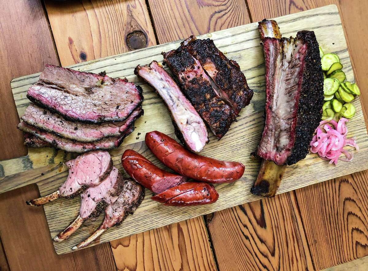 Assorted smoked meat, including lamb chops, at Harlem Road Texas BBQ