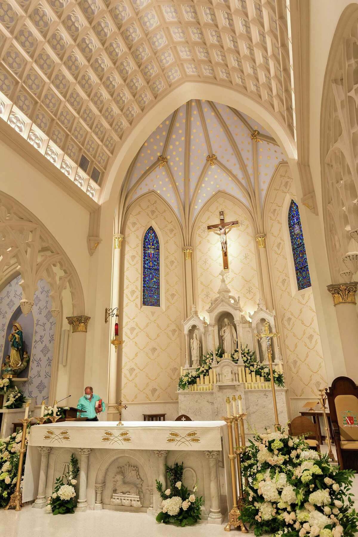 The altar of the newly renovated San Agustin Cathedral is cleared after a mass, Sunday, June 6, 2021.