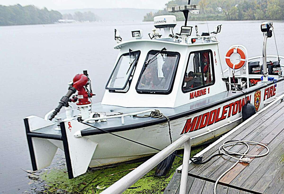 Middletown Fire Department's Marine 1 dive boat is seen moored on the Connecticut River at Harbor Park .