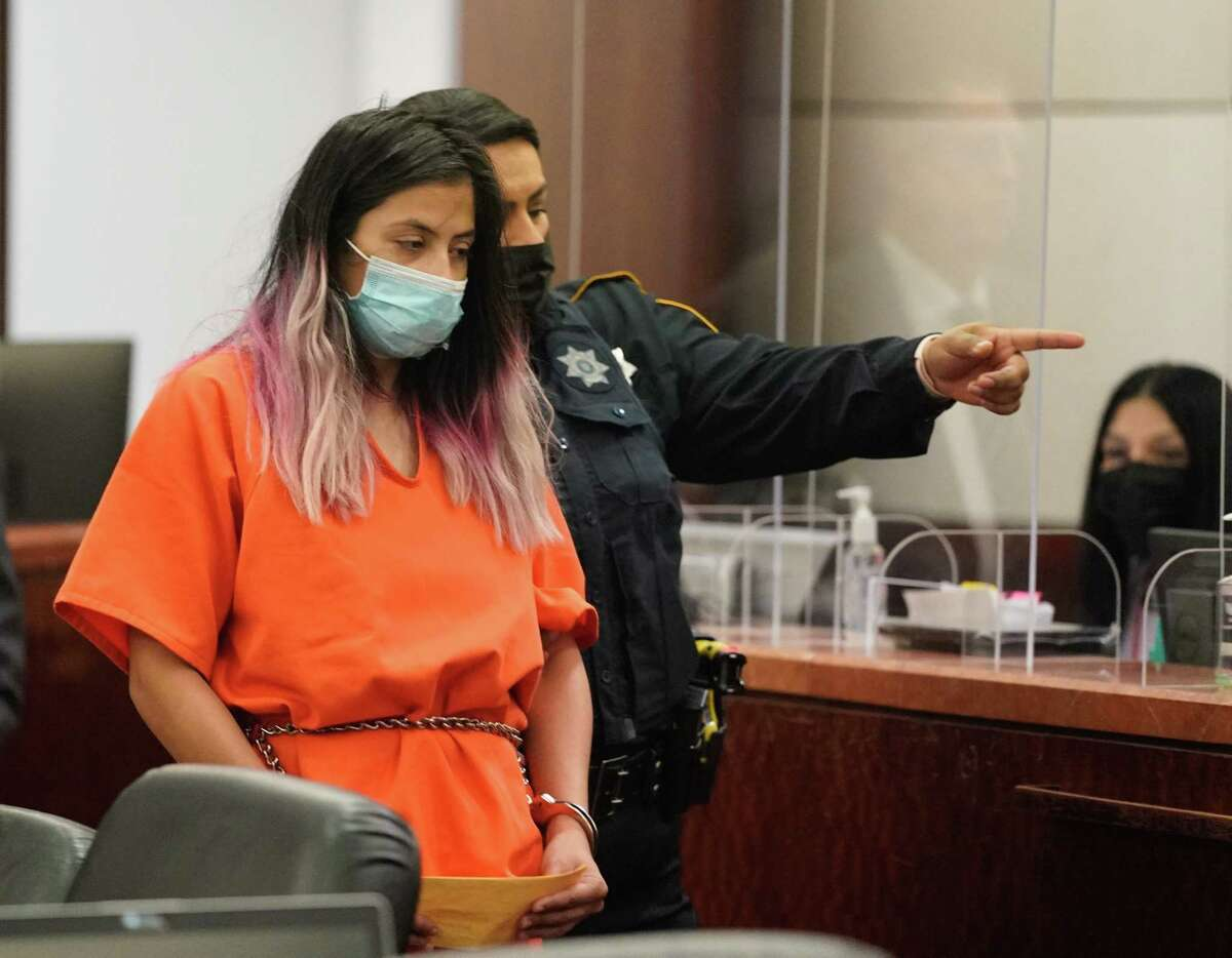 Theresa Balboa is escorted from court after an appearance in the Harris County 180th District Court Monday, June 7, 2021 in the tampering case related to the death of five-year-old Samuel Olson.