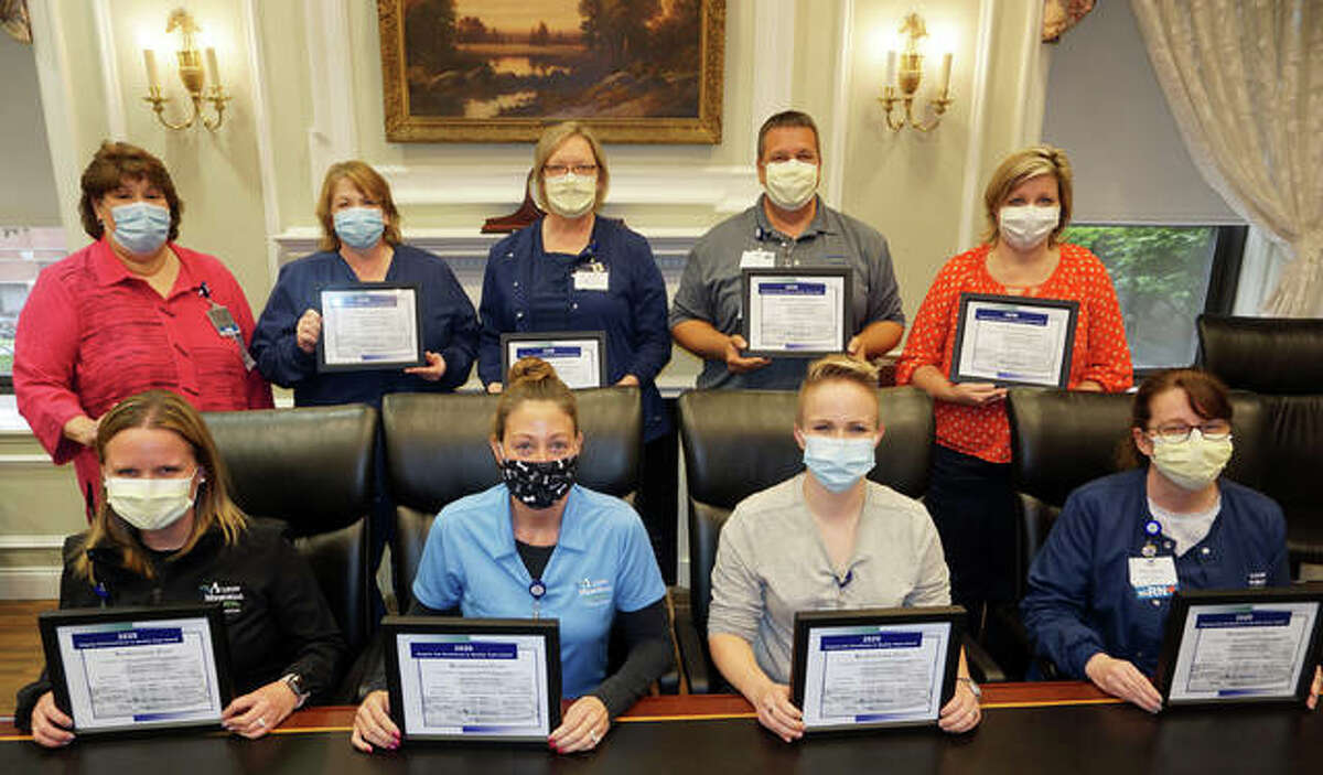 The Readmission Team is the winner of this year's Virginia Ilch Team Service Award at Alton Memorial Hospital. Team members include, front row left, Jamie Goss, Angie Liley, Kaitlin Lodes and Jamie Bock; back row from left, Debbie Turpin, Cindy Bray, Dr. Angela Holbrook, Jason Bowman and Penny Krause. Not pictured were Susan Koesterer, Sherri Henson, Dr. David Harmon, Dr. John Pargulski, Heidi Noel, Cassie Judkins and Amy Schuler.