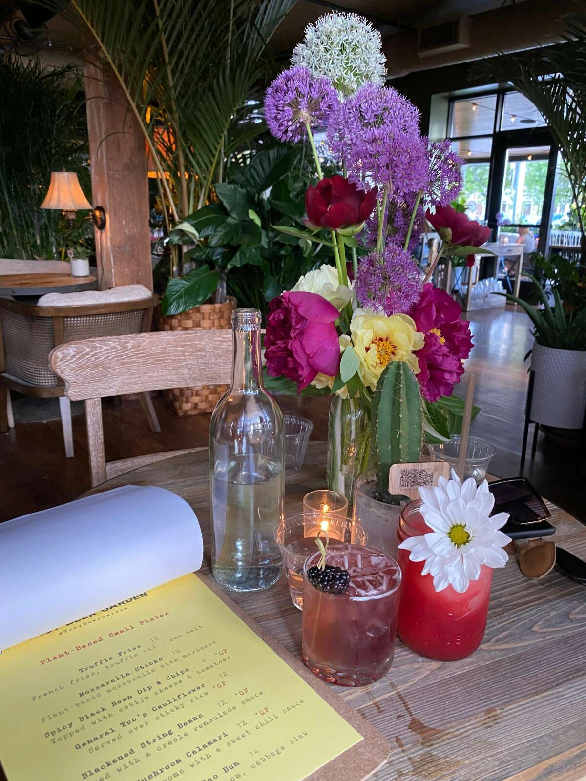Plants and flowers abound at Troy Beer Garden in Troy, which completely remakes the former Troy location of Wolff's Biergarten and includes an in-house florist. (Susie Davidson Powell/for the Times Union.)