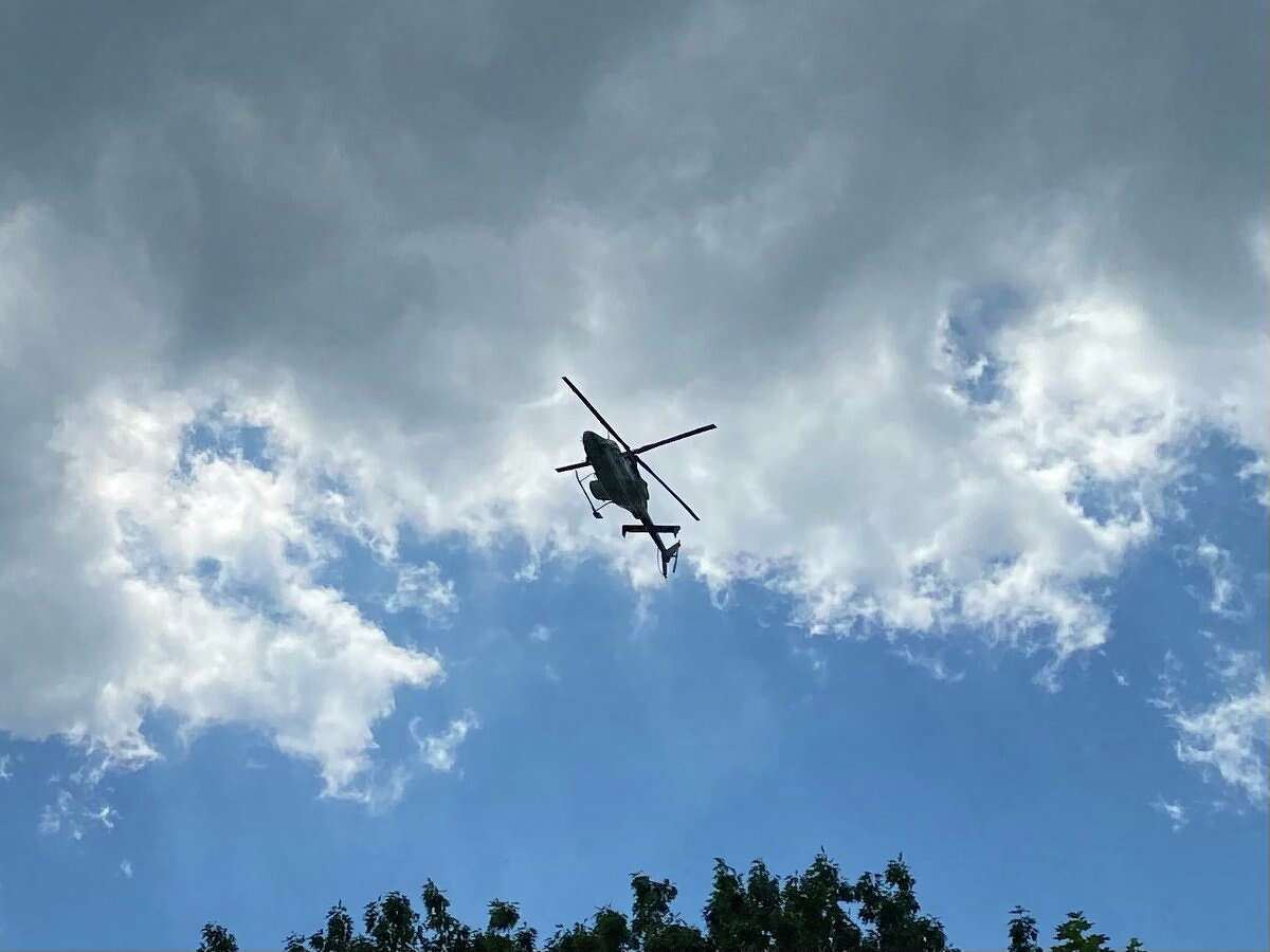 A State Police helicopter is hovering over a neighborhood in Schenectady north side as police search for a wanted man on Monday, June 7, 2021.