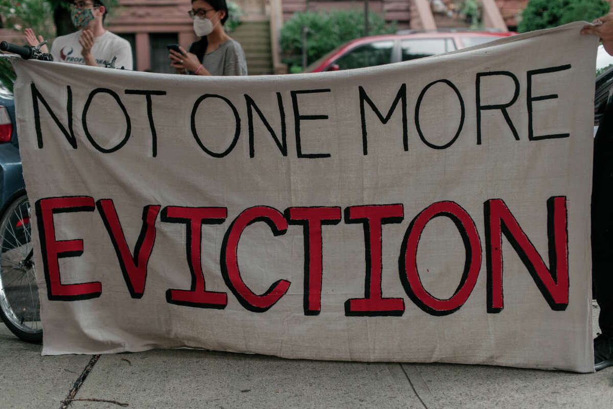 Housing activists gather to protest alleged tenant harassment by a landlord and call for cancellation of rent in the Crown Heights neighborhood on July 31, 2020 in Brooklyn, New York.