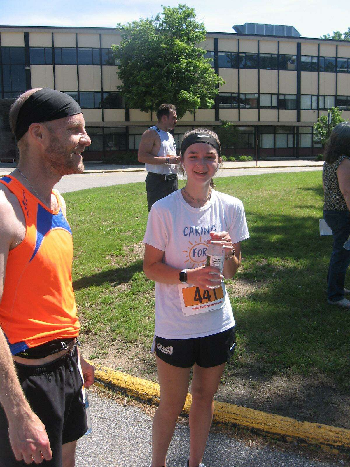 Raider Run 5K Run/Walk, held by the Torrington High School Alumni Club, was held at the high school last weekend. The first female finisher, Sophia Demichiel, center, chats with a friend after the race.