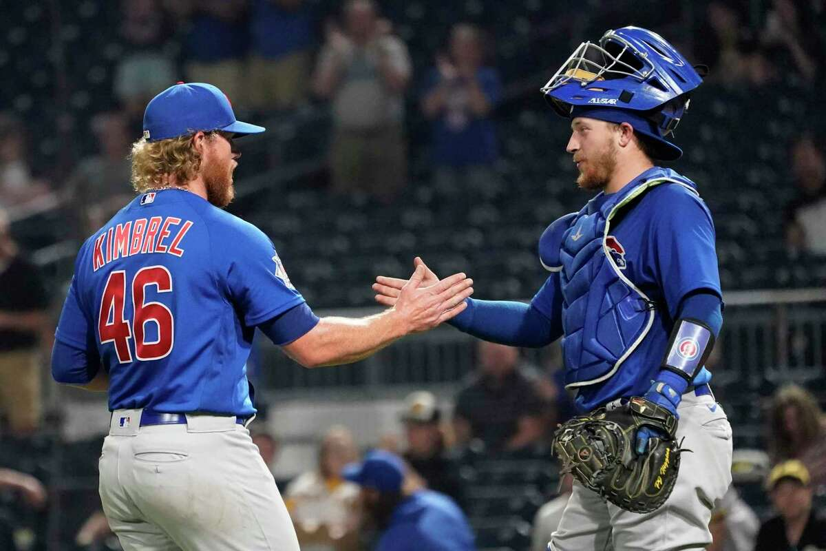 Chicago Cubs relief pitcher Craig Kimbrel (46) is greeted by catcher P.J. Higgins after the team's 4-3 over the Pittsburgh Pirates in a baseball game Tuesday, May 25, 2021, in Pittsburgh. (AP Photo/Keith Srakocic)