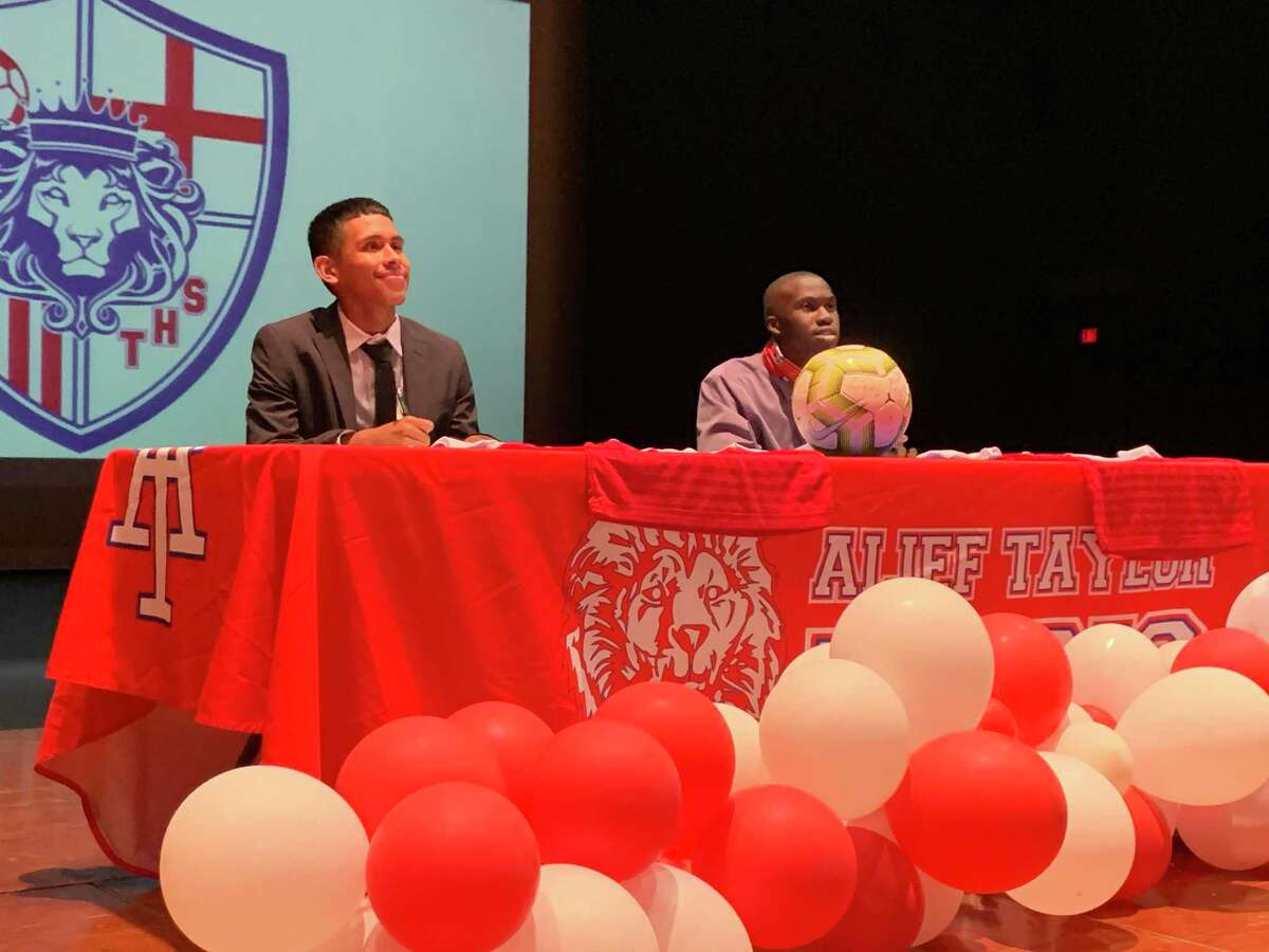 Alief Taylor soccer teammates (from left) Chris Orellana and Malachi Redhead celebrated signing day June 1 at THS. Orellana signed with Millikin University. Redhead signed with Iowa Wesleyan University.