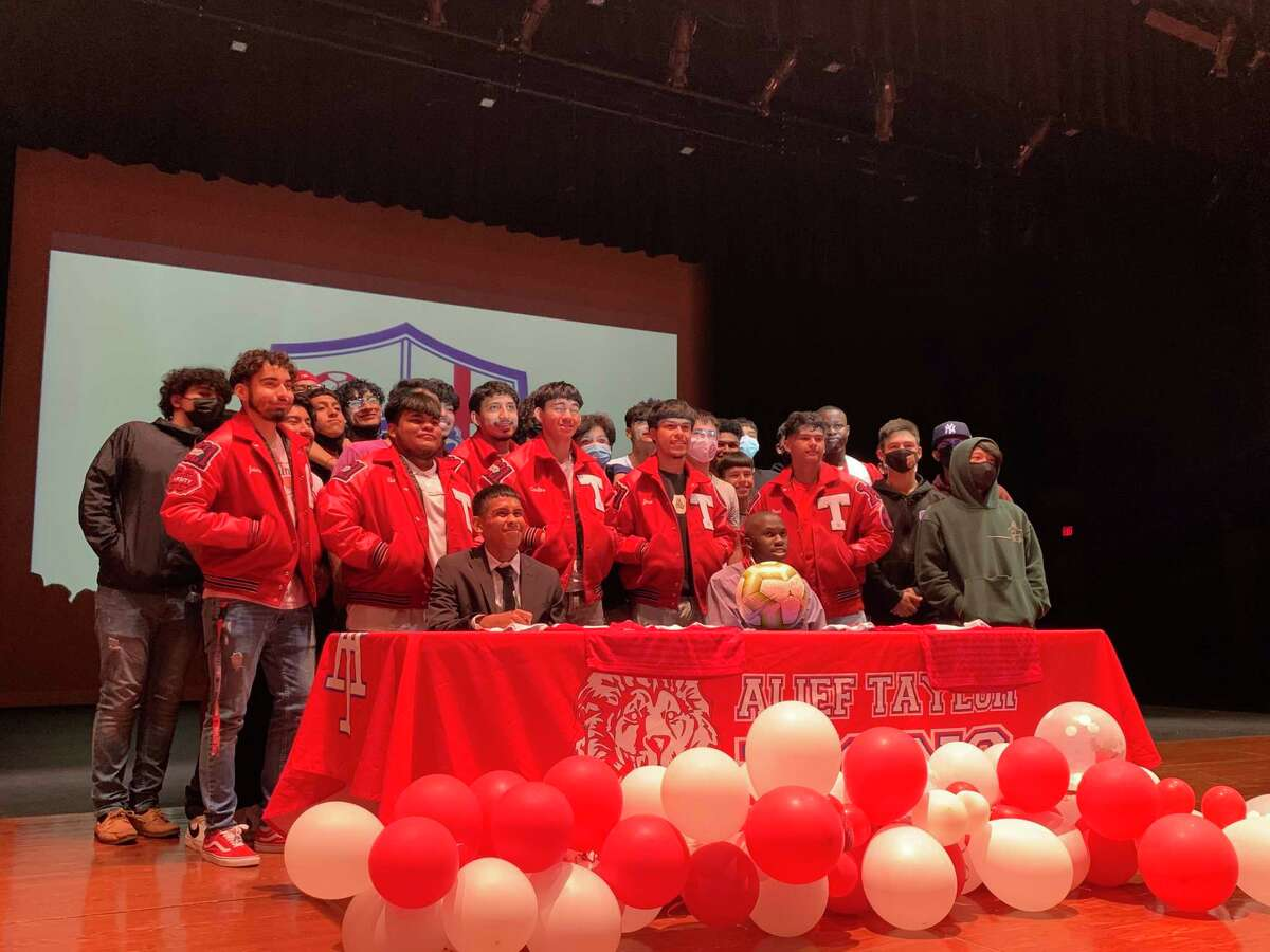 The Alief Taylor boys soccer team celebrated signing day at THS with seniors Chris Orellana (front left) and Malachi Redhead (front right).