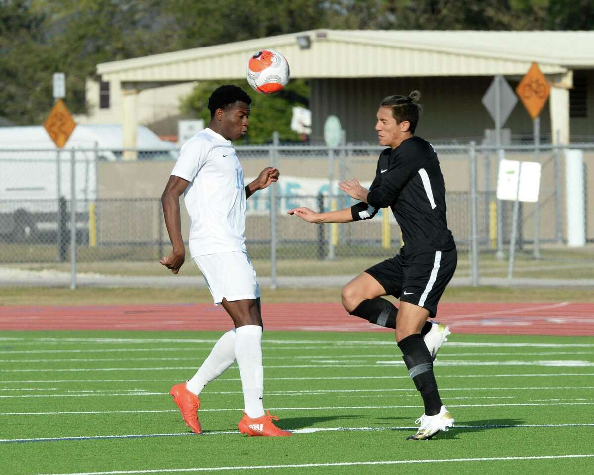 Toheeb Oladipupo (14) of Paetow heads a ball in the first half of the boys soccer game between the Paetow Panthers and the Mayde Creek Rams during the Mojo Showcase on Saturday, January 9, 2021 at Mayde Creek High School, Houston, TX.