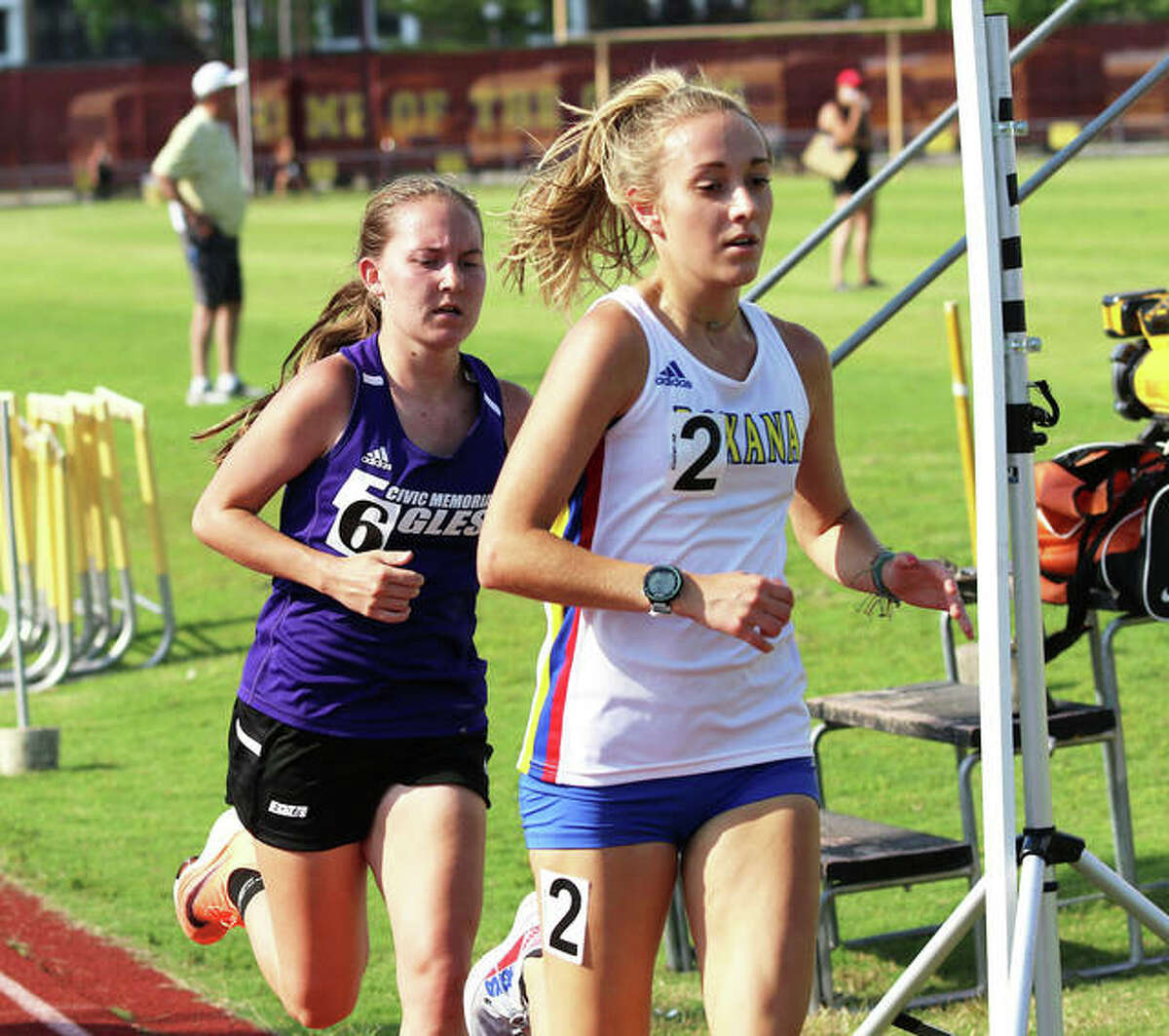 Roxana's Janelynn Wirth (right) leads CM's Hannah Meiser with 800 meters left in the 3,200 at the Class 2A sectional girls track meet Friday in Wood River. Wirth ran second, with Meiser 13 second back in third.