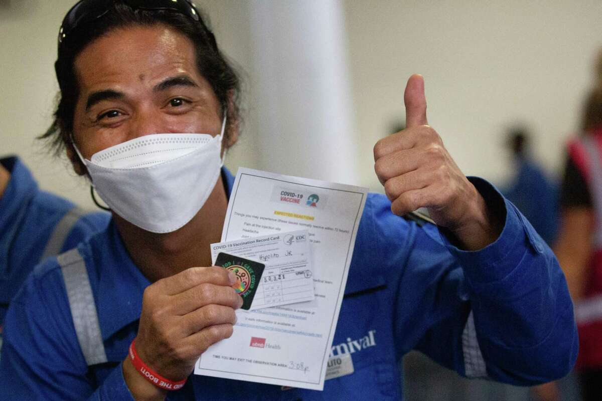 Carnival Cruise crew member gives a thumbs up after receiving a Pfizer COVID-19 vaccine at the Port of Galveston, May 3, 2021.