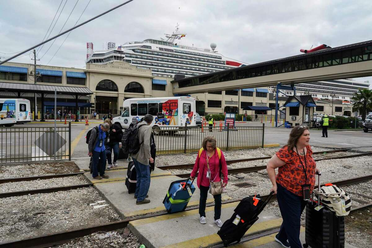 Passengers of Carnival Cruise Line leave the Port of Galveston Cruise Terminal on March 8, 2020 in Galveston, Texas.