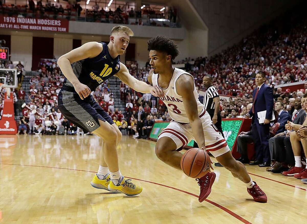 Indiana's Justin Smith (3) goes to the basket past Marquette's Sam Hauser during the second half of an NCAA college basketball game Wednesday, Nov. 14, 2018, in Bloomington, Ind. Indiana won 96-73. (AP Photo/Darron Cummings)