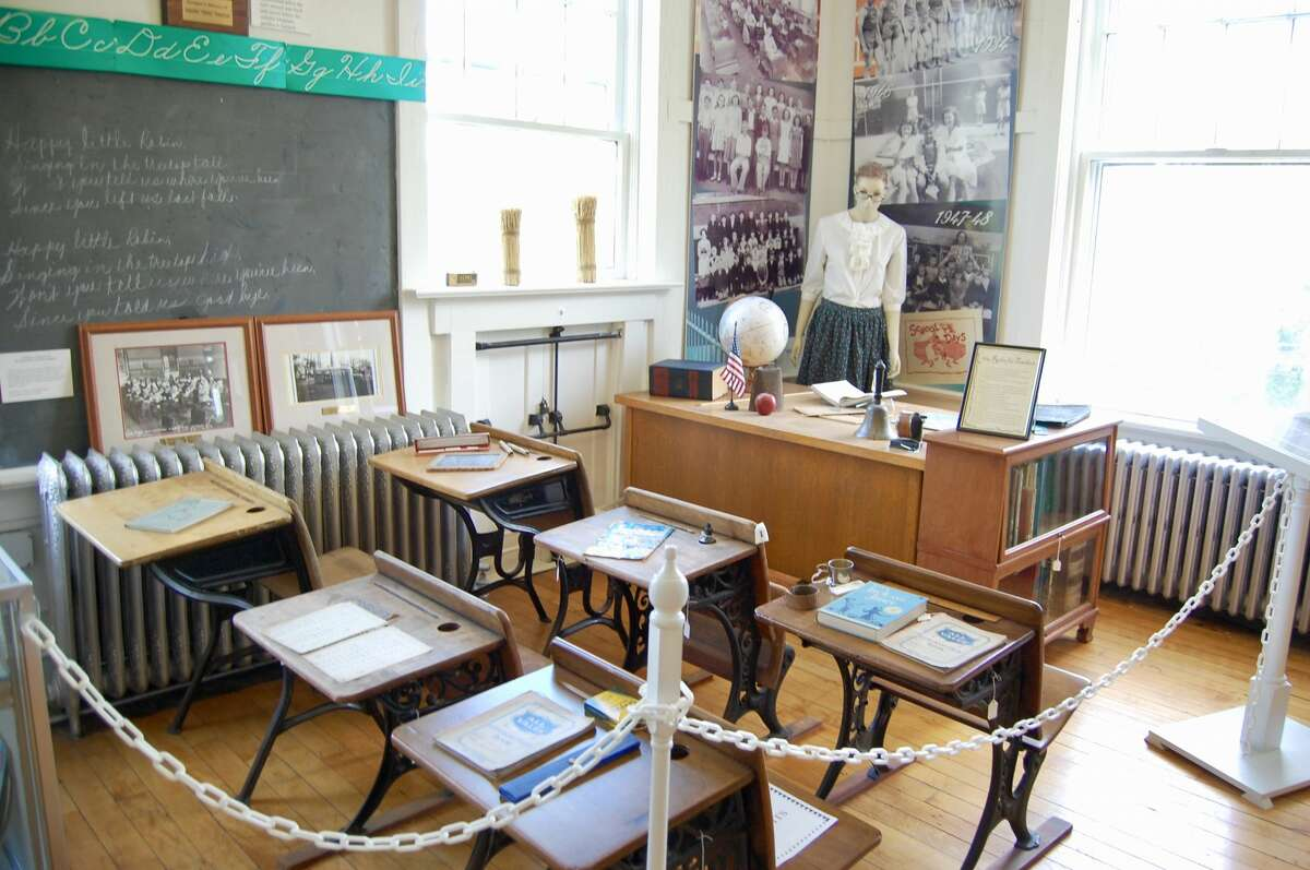 The building was first a school house, and a display with authentic desks and chalkboard from the early-1900s is on display.