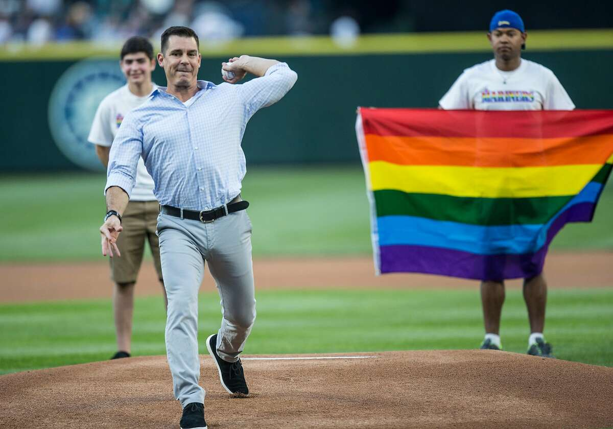 Billy Bean, Major League Baseball's first ambassador for inclusion, throws the ceremonial first pitch for Seattle's Pride Night in 2016 before a game between the Mariners and the Brewers.