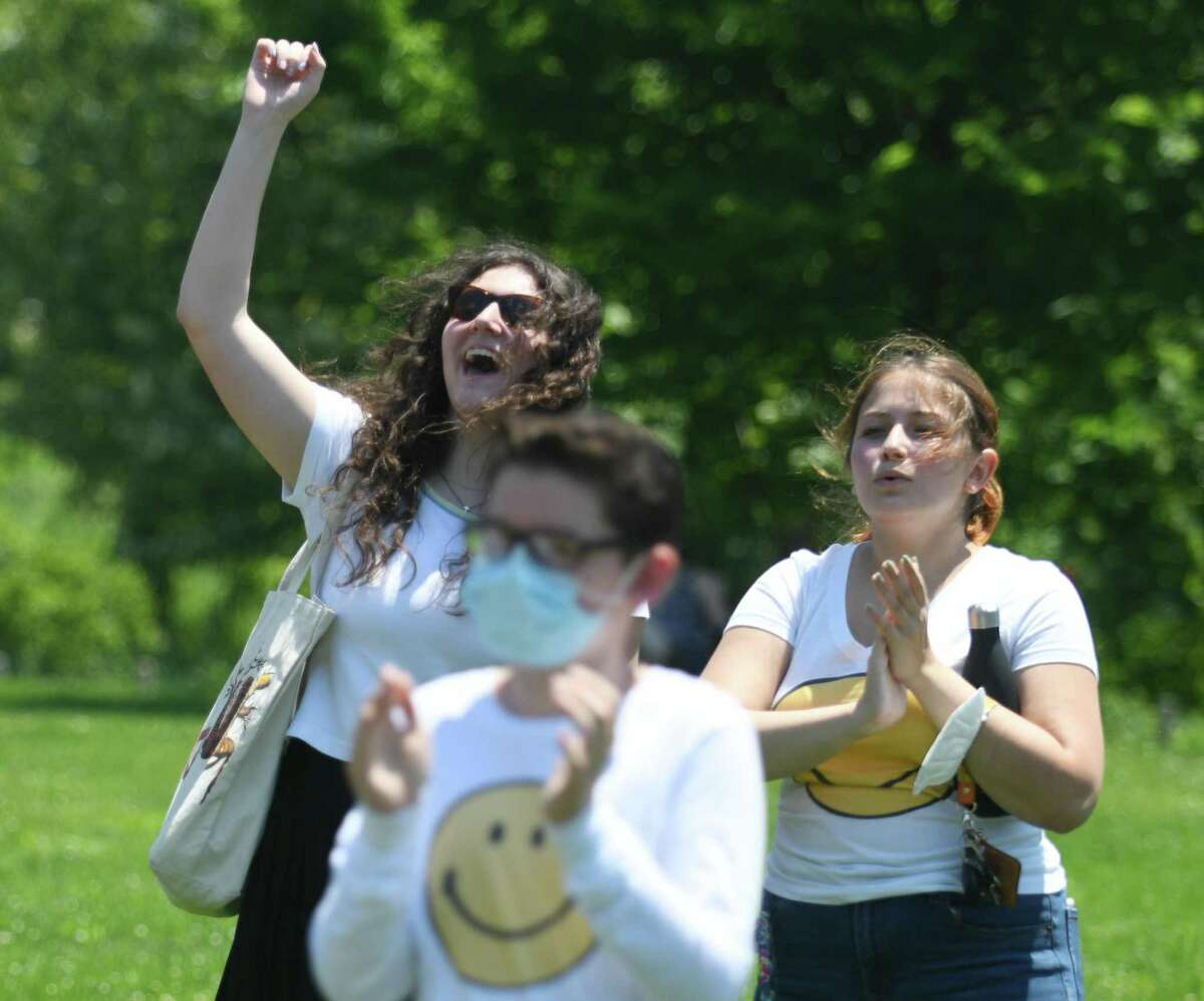 Hannah Schafer, left, and Emma Valerio cheer during performances at the Stamford Public Education Foundation (SPEF) Springtime Celebration at Mill River Park in Stamford, Conn. Sunday, June 6, 2021. The event featured performances by Project Music, Stamford High School's Strawberry Hill Players, Westhill High School's Jazz Ensemble, Stamford High Madrigals, and Stamford Hoop Girls. Rippowam Middle School's Sid Watson provided DJ music between sets and winners of Excellence in Education awards were announced.
