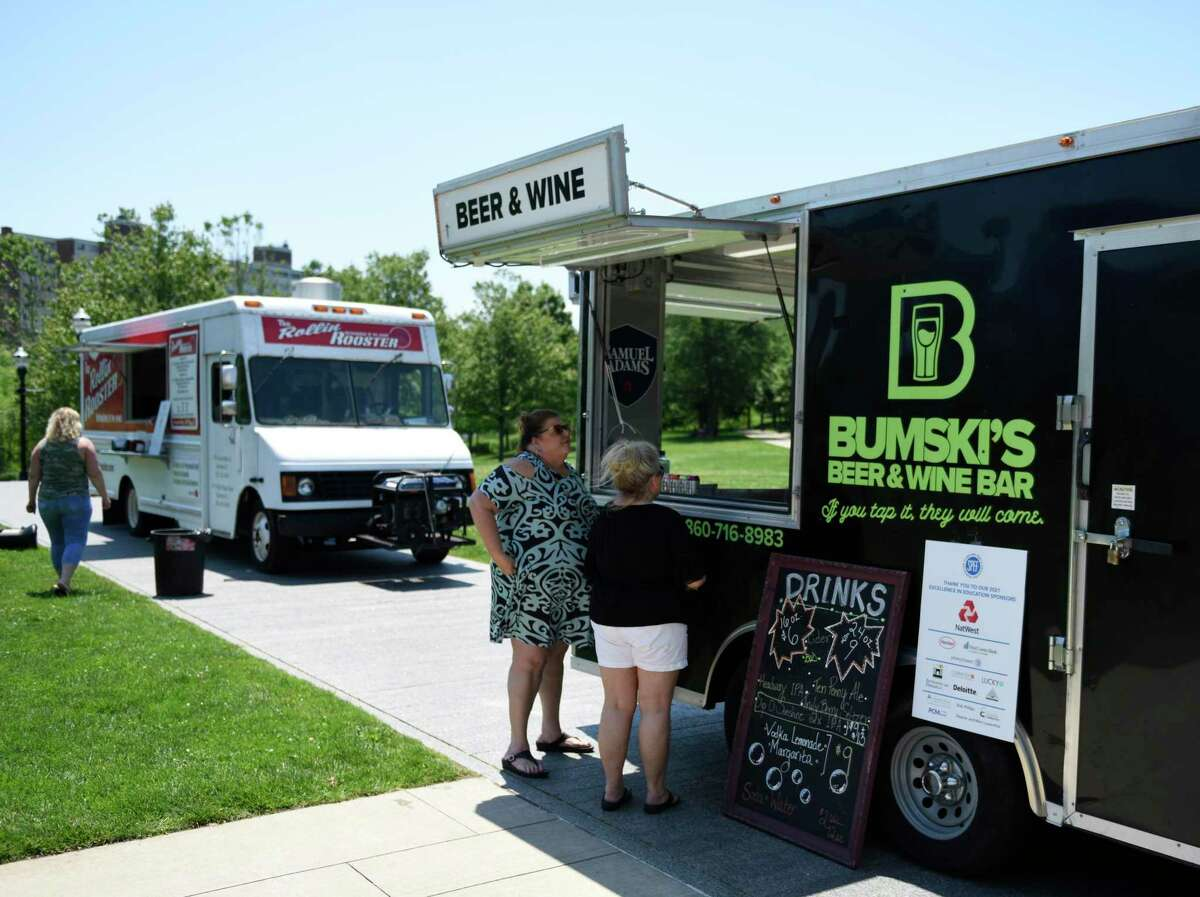Folks order from a food truck at the Stamford Public Education Foundation (SPEF) Springtime Celebration at Mill River Park in Stamford, Conn. Sunday, June 6, 2021. The event featured performances by Project Music, Stamford High School's Strawberry Hill Players, Westhill High School's Jazz Ensemble, Stamford High Madrigals, and Stamford Hoop Girls. Rippowam Middle School's Sid Watson provided DJ music between sets and winners of Excellence in Education awards were announced.