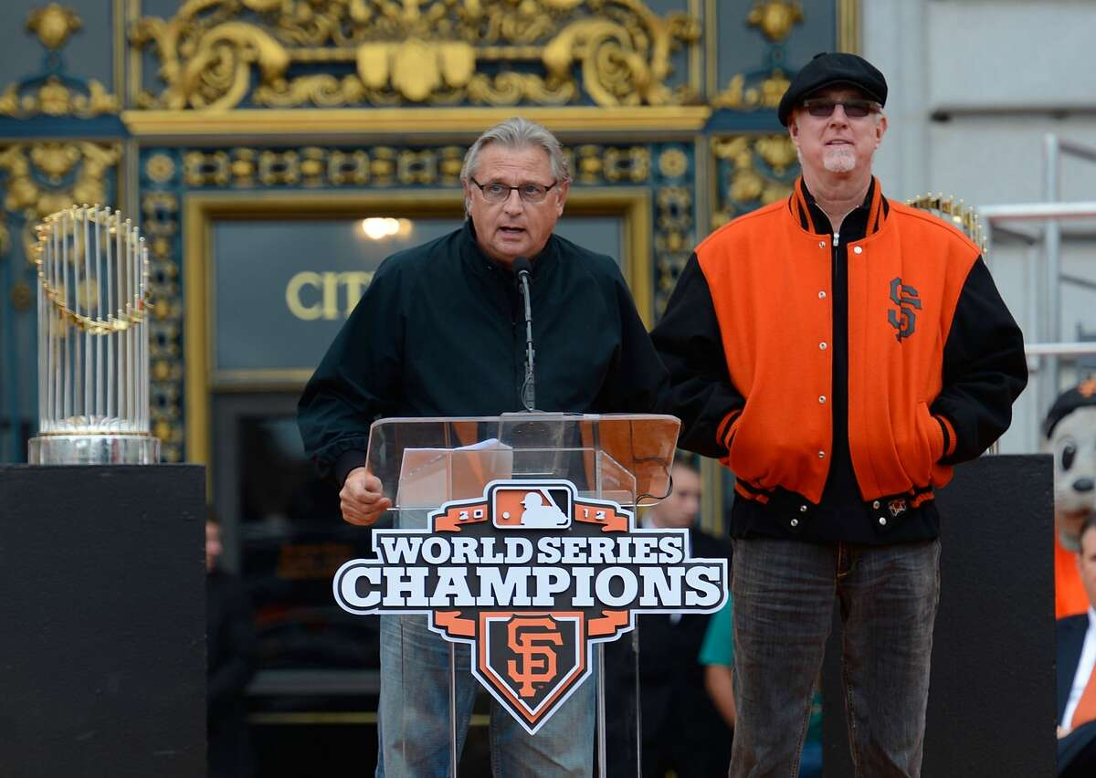 The San Francisco Giants broadcast team of Duane Kuiper (L) and Mike Krukow (R) speaks to the fans during the Giants' victory parade and celebration on October 31, 2012 in San Francisco, California.