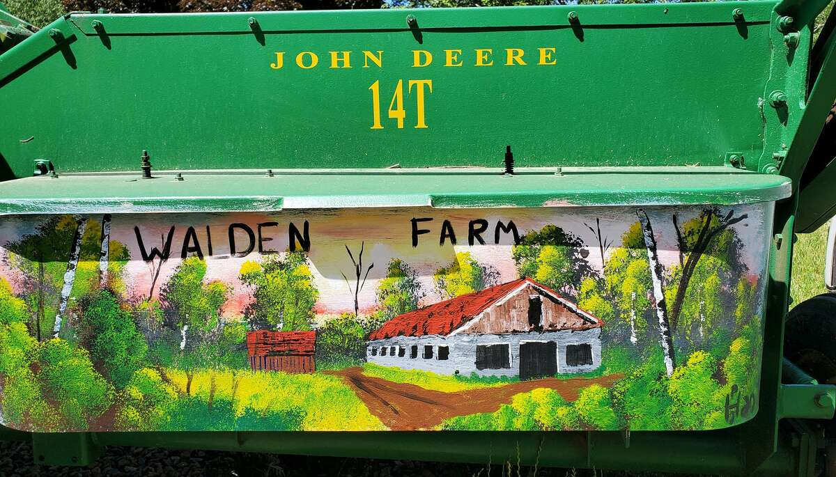 Paul Hanush of Hebron painted a tractor at Walden Farm, located in the Moodus section of East Haddam. The farm was one of two that recently received state agricultural grants intended to help strengthen farmers looking to expand, diversify or improve their existing operations.