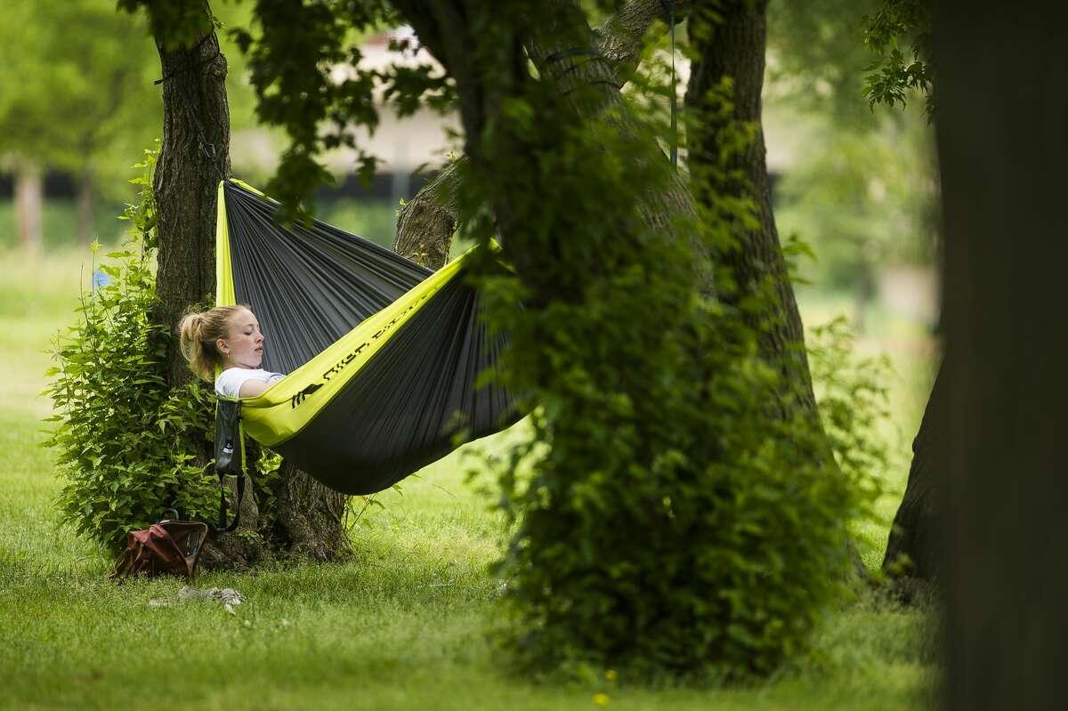 People enjoy the warm weather by recreating near the Tridge Monday, June 7, 2021 in Midland. (Katy Kildee/kkildee@mdn.net)