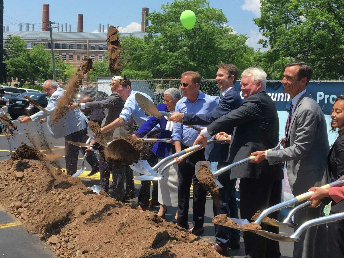 A host of officials break ground for a new biosciences building at 101 College St. on Monday, June 7, 2021, including, from left, Southern Connecticut State University President Joseph Bertolini, Gateway Community College CEO William Brown, Yale University President Peter Salovey, Mayor Justin Elicker, New Haven Superintendent of Schools Illine Tracey, Gov. Ned Lamont, BioLabs founder and President Johannes Fruehauf, Arvinas President and CEO John Houston, developer Carter Winstanley and SCSU BioPath student Apple Pham.