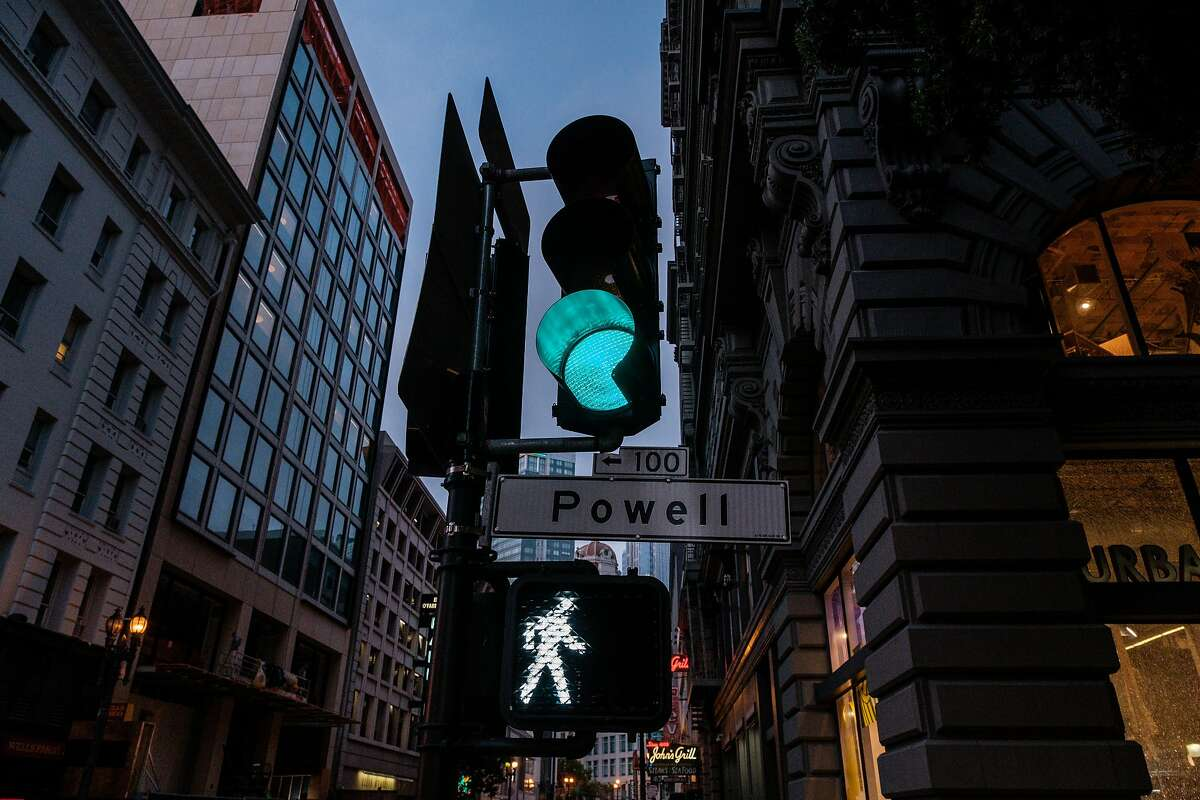 A traffic light is seen in downtown S.F. The city is fighting PG&E's revision of terms for infrastructure connections.