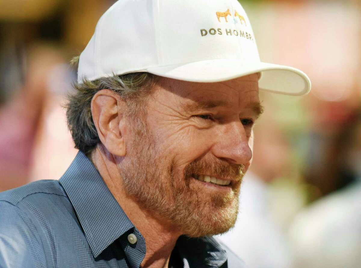 Emmy Award-winning actor Bryan Cranston signs bottles of his new mezcal spirit Dos Hombres at Stew Leonard's Wines & Spirits in Norwalk, Conn. Monday, June 7, 2021. Cranston is best known for his lead role in the AMC series