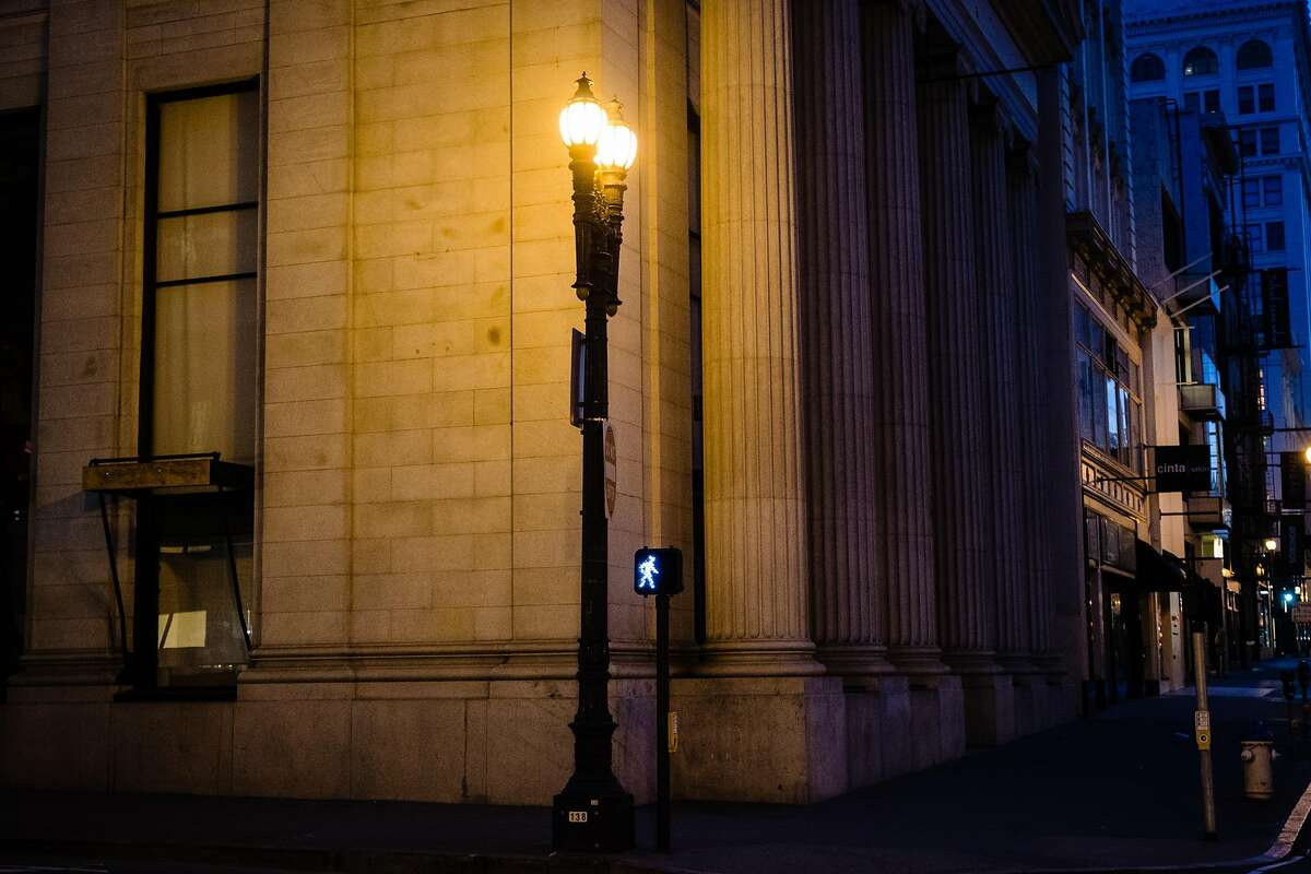 A streetlight is seen illuminated in downtown San Francisco on Friday. PG&E wants to require technological upgrades at various facilities, including stoplights and streetlights, that would require the city to install meters and serve them with PG&E's power instead of electricity the city generates at Hetch Hetchy. City officials say the plan could cost $1 billion to implement.