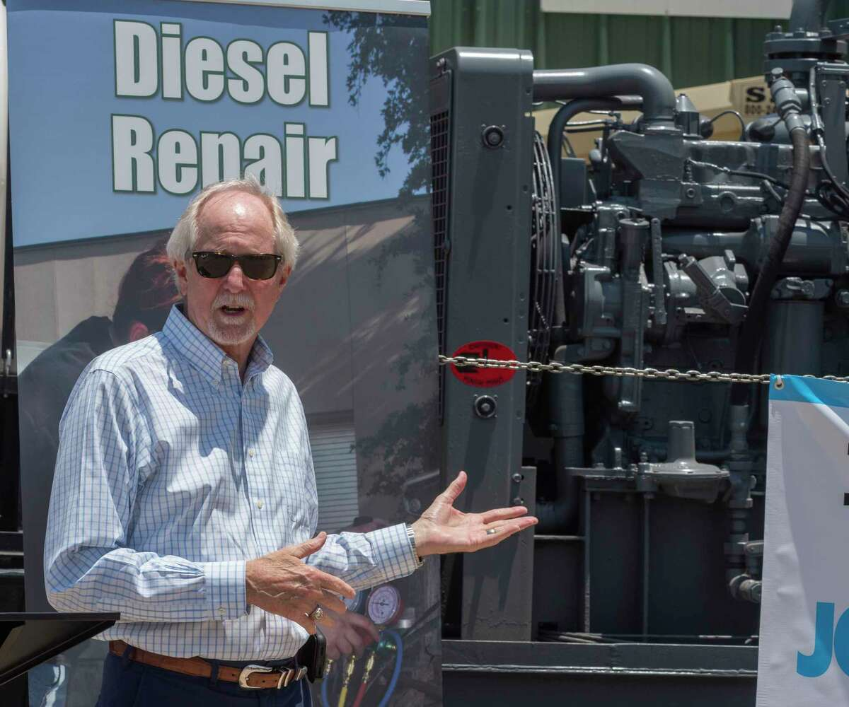 Steve Thomas, president of Midland College, talks about the industry partnerships and how they help all parties in front of the Archrock Inc. diesel compressor donated to Midland College to aid students in learning diesel technology repairs 06/07/2021 outside the Midland College Cogdell Technical Building. Tim Fischer/Reporter-Telegram