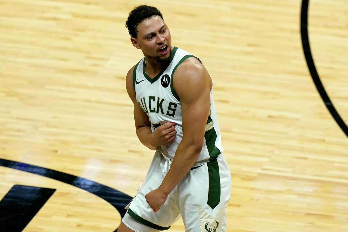 Milwaukee Bucks guard Bryn Forbes reacts after scoring on a 3-pointer during the second half of Game 4 of an NBA basketball first-round playoff series against the Miami Heat, Saturday, May 29, 2021, in Miami. (AP Photo/Lynne Sladky)