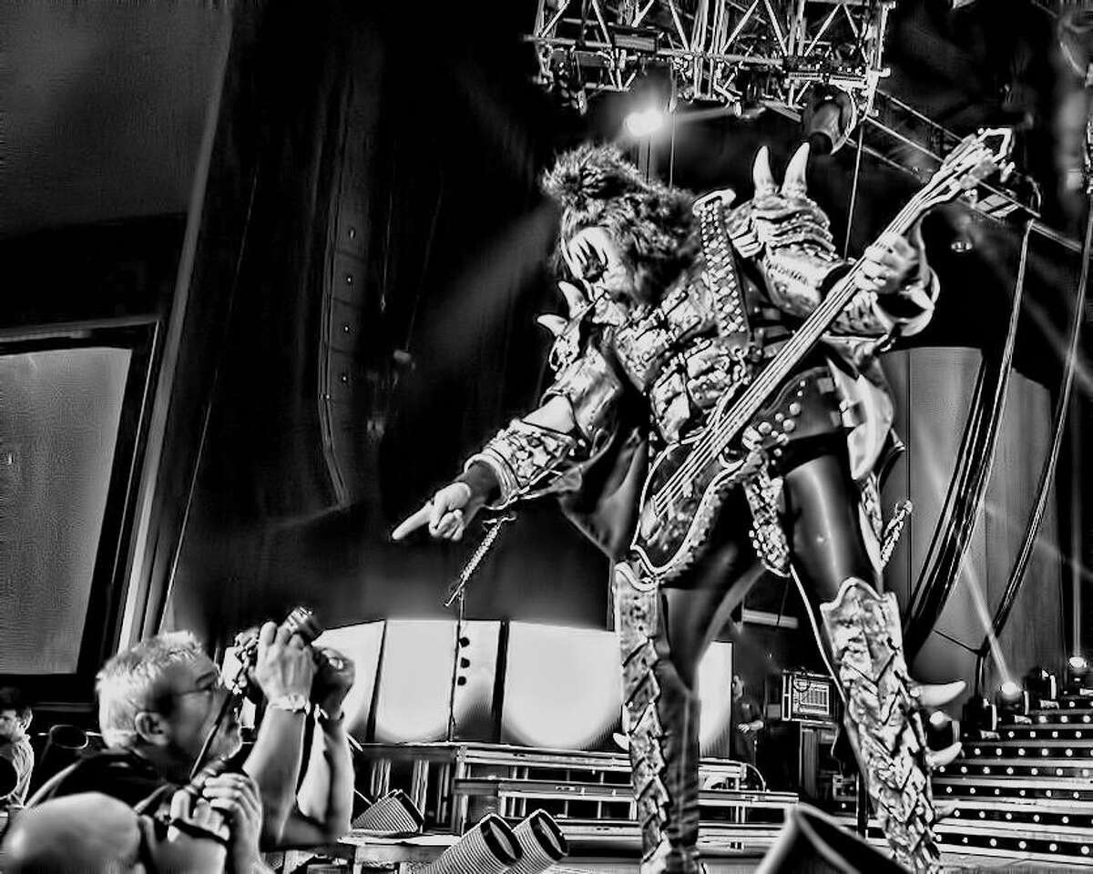 """A photo by The Woodlands photographer Ted Washington of Gene Simmons from KISS at the Cynthia Woods Mitchell Pavilion. This is one of the images to be included in Volume 2 of """"Raising a Hand for Rett."""""""