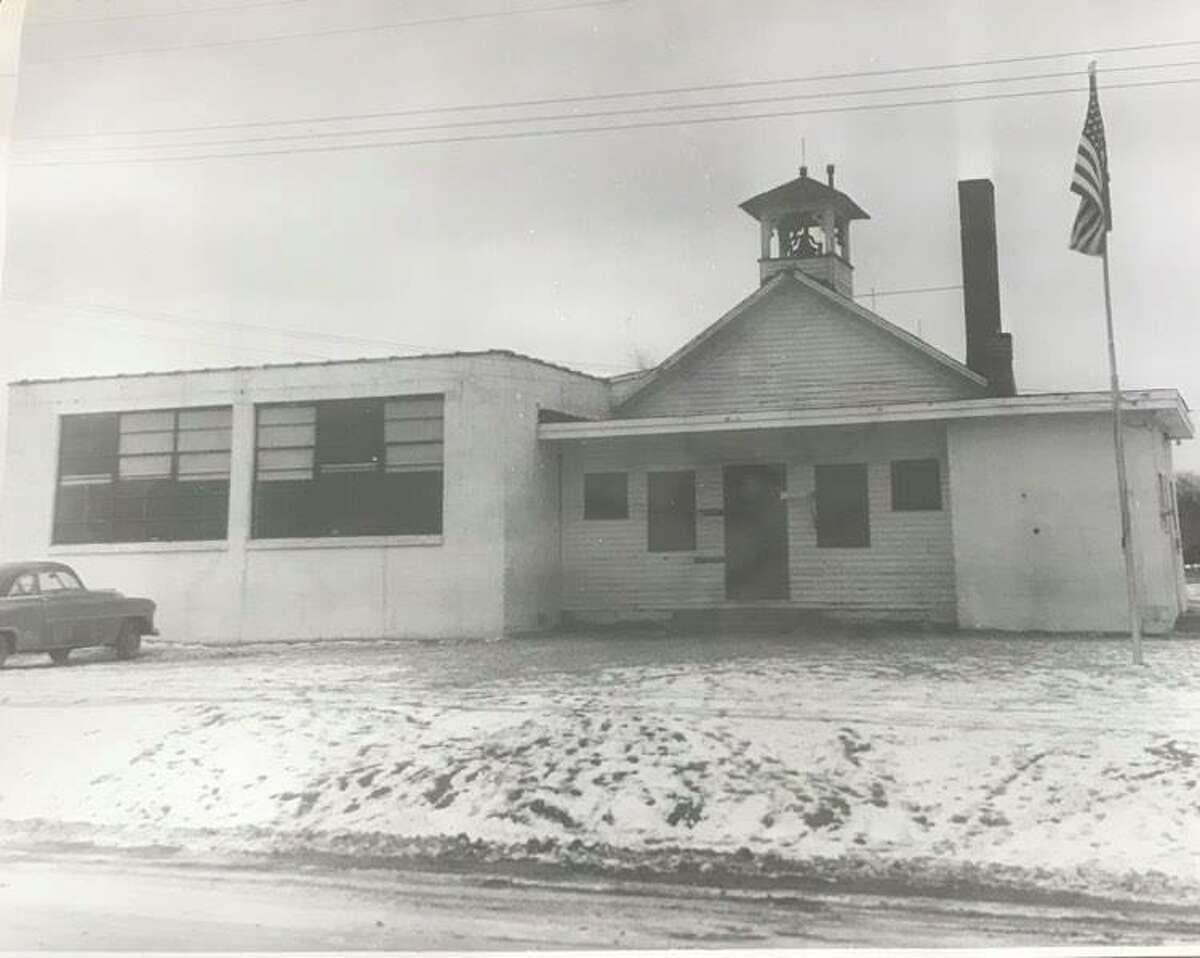 The original Cady school, with schoolbell on Sturgeon Road. Cady had two additions since the building was first constructed. January 1956