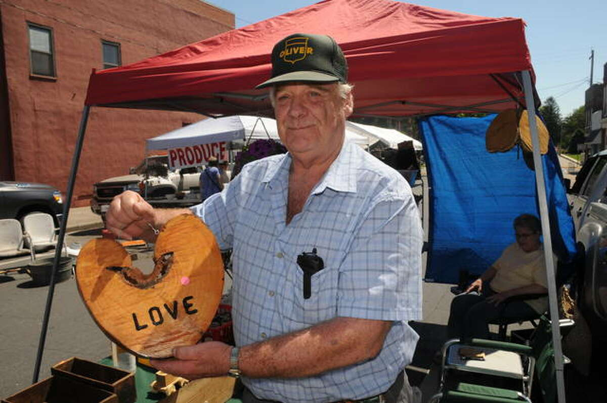 """Don Henschen of Mount Olive was at Carlinville Market Days selling his wood creations, including this piece that he felt would make the """"perfect heart."""""""