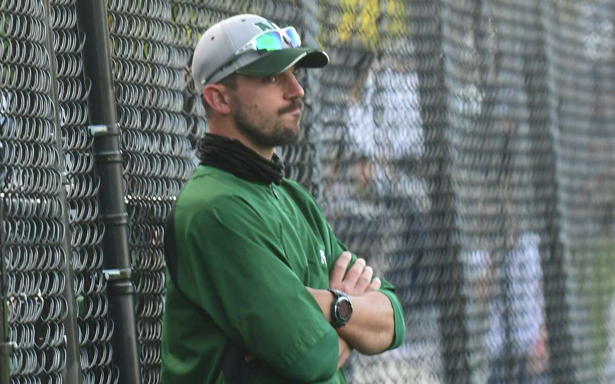 Norwalk coach Ryan Mitchell is shown during a May 12 game against McMahon.