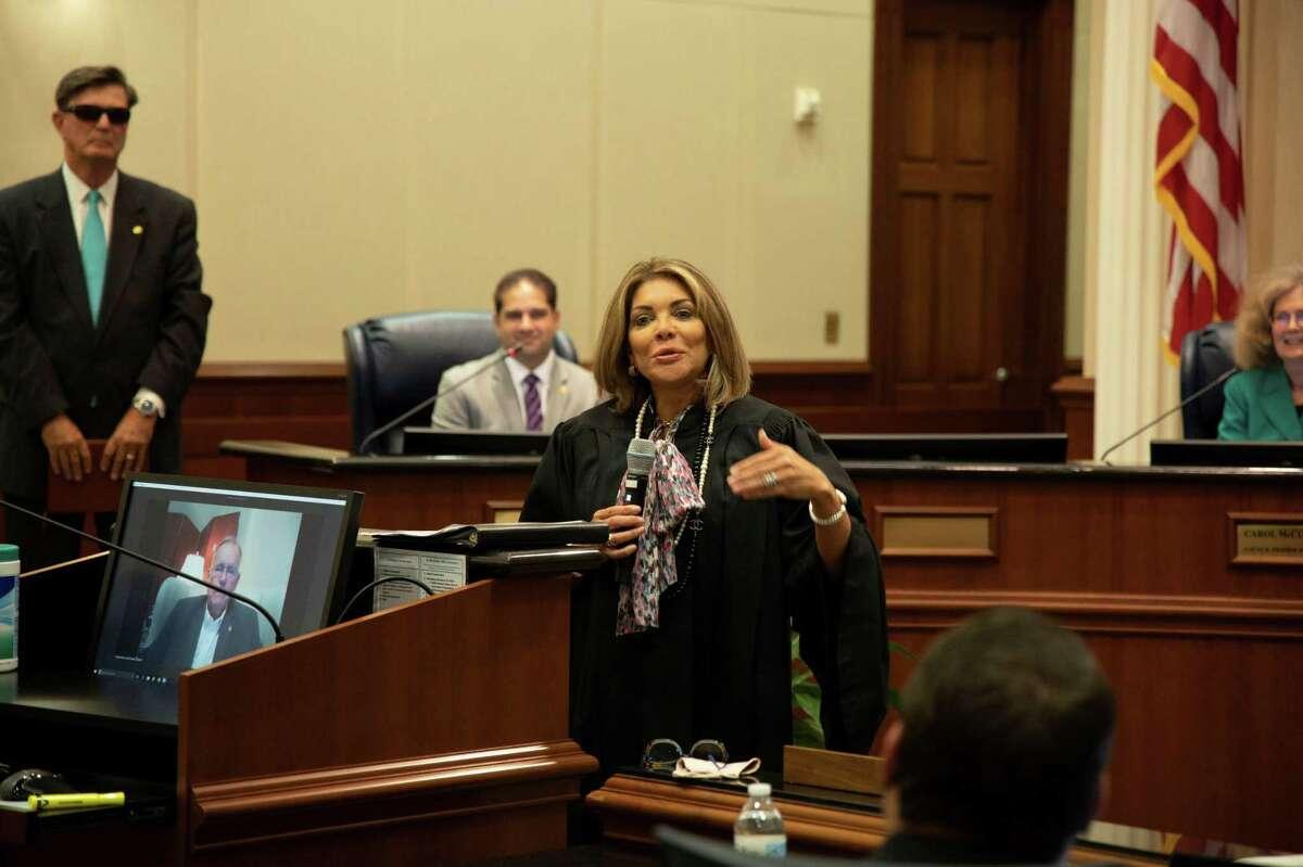 Texas Supreme Court Justice Eva Guzman, shown here presiding over the swearing-in ceremony of Sugar Land Mayor Joe Zimmerman.