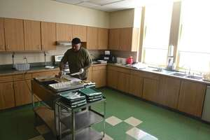 Chef Jason Streck-Weller , of the Community Culinary School of Northwestern CT, serves Monday lunch at the New Milford Senior Center. Monday, June 7, 2021, in New Milford, Conn.