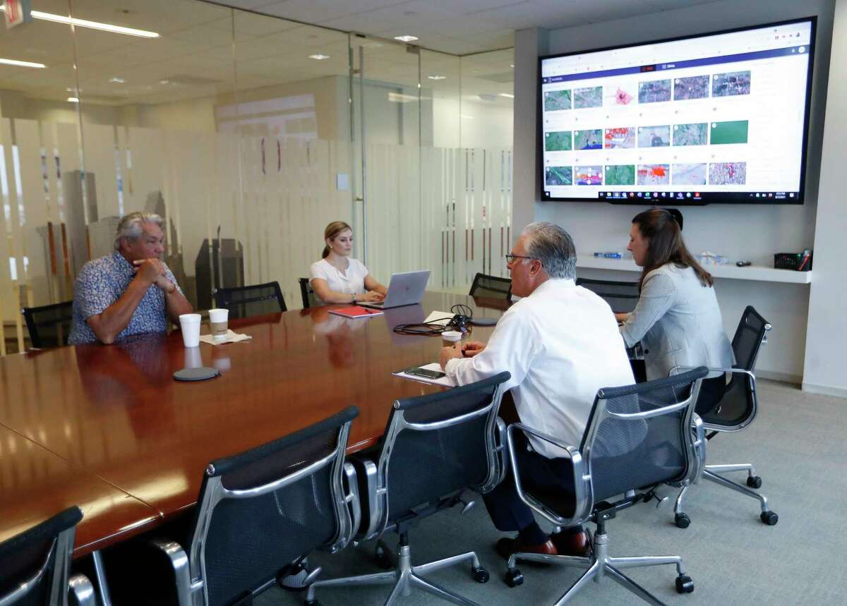 Employees in the conference room at commercial real estate firm JLL, Monday, June 7, 2021, in Houston. A study by JLL shows people are ready to get back to the office, want flexibility in where they work, crave 'real' human interactions with colleagues and miss a change of scenery.