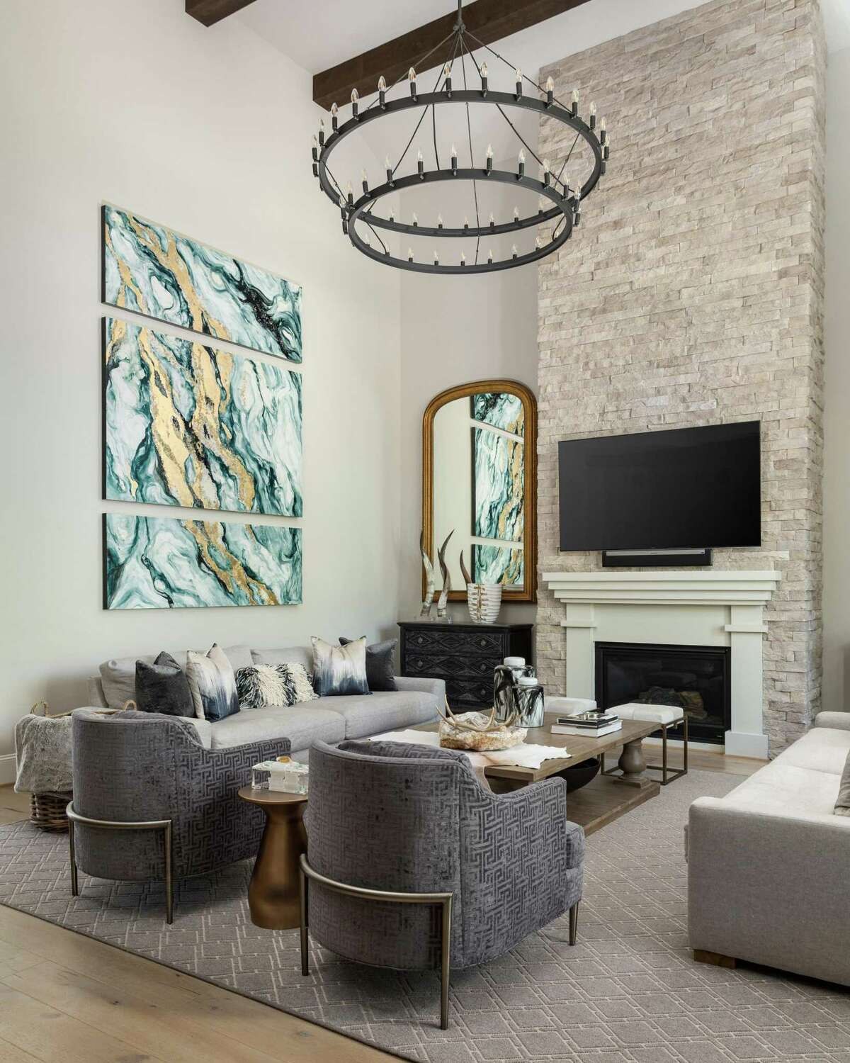 In a room with tall ceilings, go with largle-scale art and lighting.