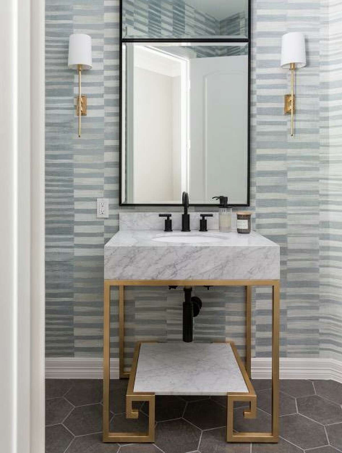 Wallpaper and great lighting are beautiful finishing touches in a powder bathroom.