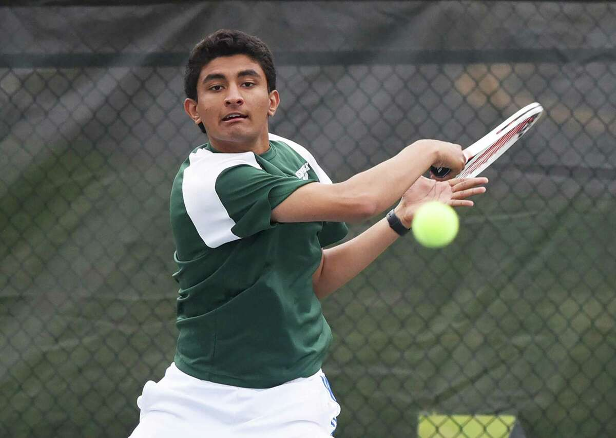 Norwalk's Prem Dave hits a forehand shot during a match in New Canaan on May 10.